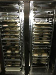 pizza dough on sheet pans